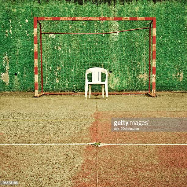 Soccer net  with white chair