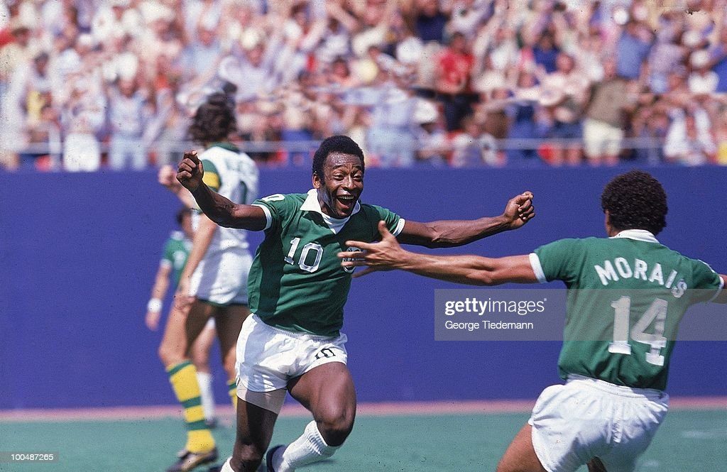 New York Cosmos Pele (10) victorious with Nelsi Morais (14) after scoring goal vs Tampa Bay Rowdies. East Rutherford, NJ 1/1/1977--9/30/1977