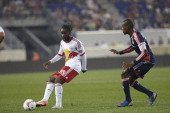 New York Red Bulls Pegguy Luyindula in action vs New England Revolution Jose Goncalves Goncalo Santos at Red Bull Arena Harrison NJ CREDIT Guillermo...