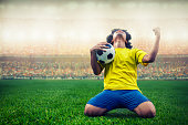 soccer or football player celebrating goal in the stadium during match
