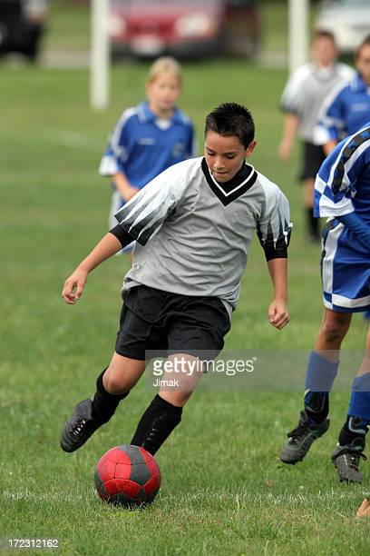 Soccer player ADK carries the ball