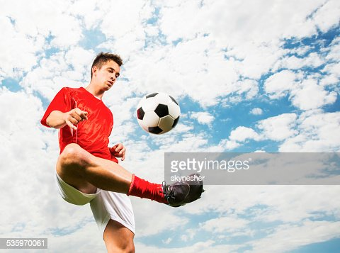 Soccer player against blue sky. : Stock Photo