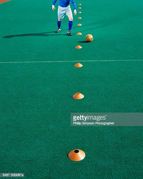 Soccer Player and Cones