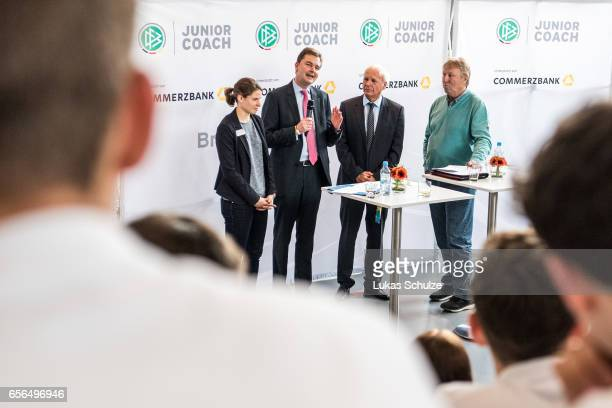Soccer player Annike Krahn Andre Carls of Commerzbank moderator Wolfgang Staab and former soccer coach Horst Hrubesch talk to the DFB Junior Coaches...
