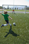 Soccer player attempting goal