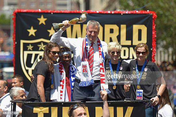 Soccer player Carli Lloyd Chirlane McCray Mayor Bill de Blasio soccer player Megan Rapinoe and US Coach Jill Ellis aboard a float in the New York...
