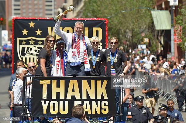 Soccer player Carli Lloyd Chirlane McCray Mayor Bill de Blasio soccer player Megan Rapinoe and US Coach Jill Ellis aboard a float in the New York...