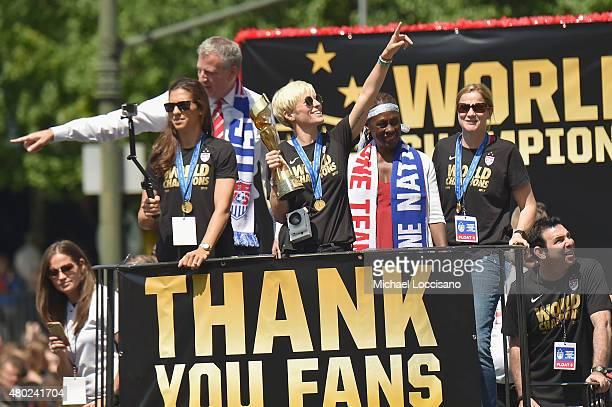 Soccer player Carli Lloyd Mayor Bill de Blasio soccer player Megan Rapinoe Chirlane McCray and US Coach Jill Ellis aboard a float in the New York...
