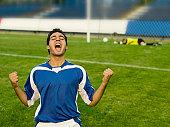 A soccer player celebrating a goal