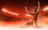 soccer player celebrating a goal on red smoke background