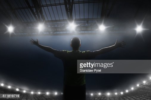 Soccer player celebrating victory in stadium