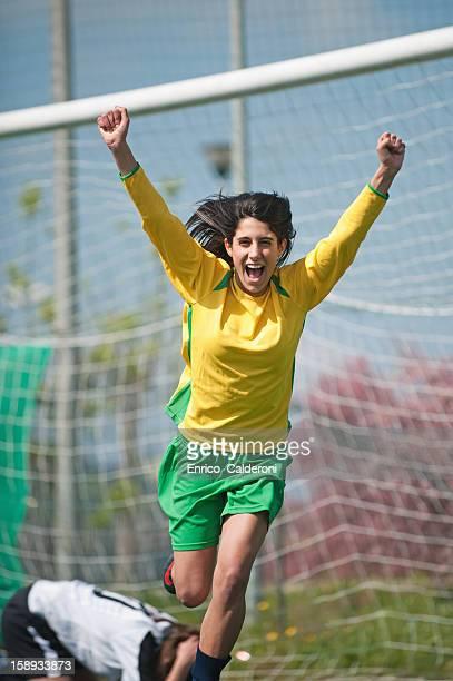 Soccer player celebrating victory