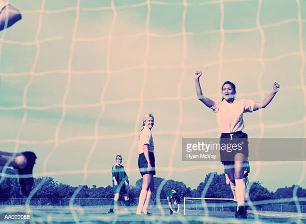 Soccer Player Celebrating, View Through Net