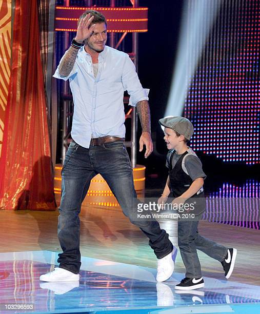 Soccer player David Beckham and Cruz Beckham onstage during the 2010 Teen Choice Awards at Gibson Amphitheatre on August 8 2010 in Universal City...