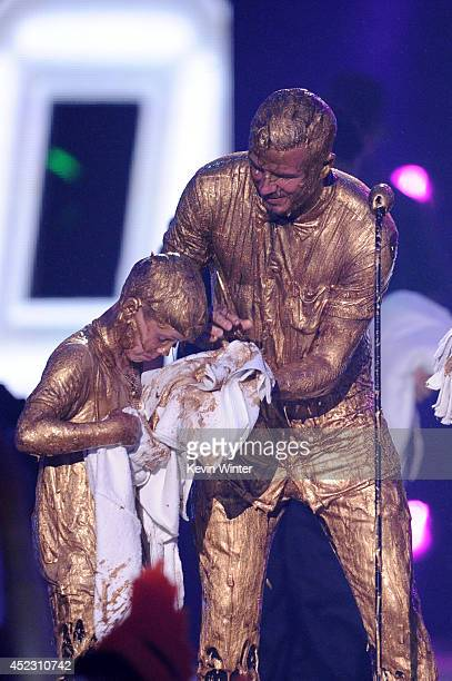 Soccer player David Beckham with Cruz Beckham get slimed speaks onstage during Nickelodeon Kids' Choice Sports Awards 2014 at UCLA's Pauley Pavilion...