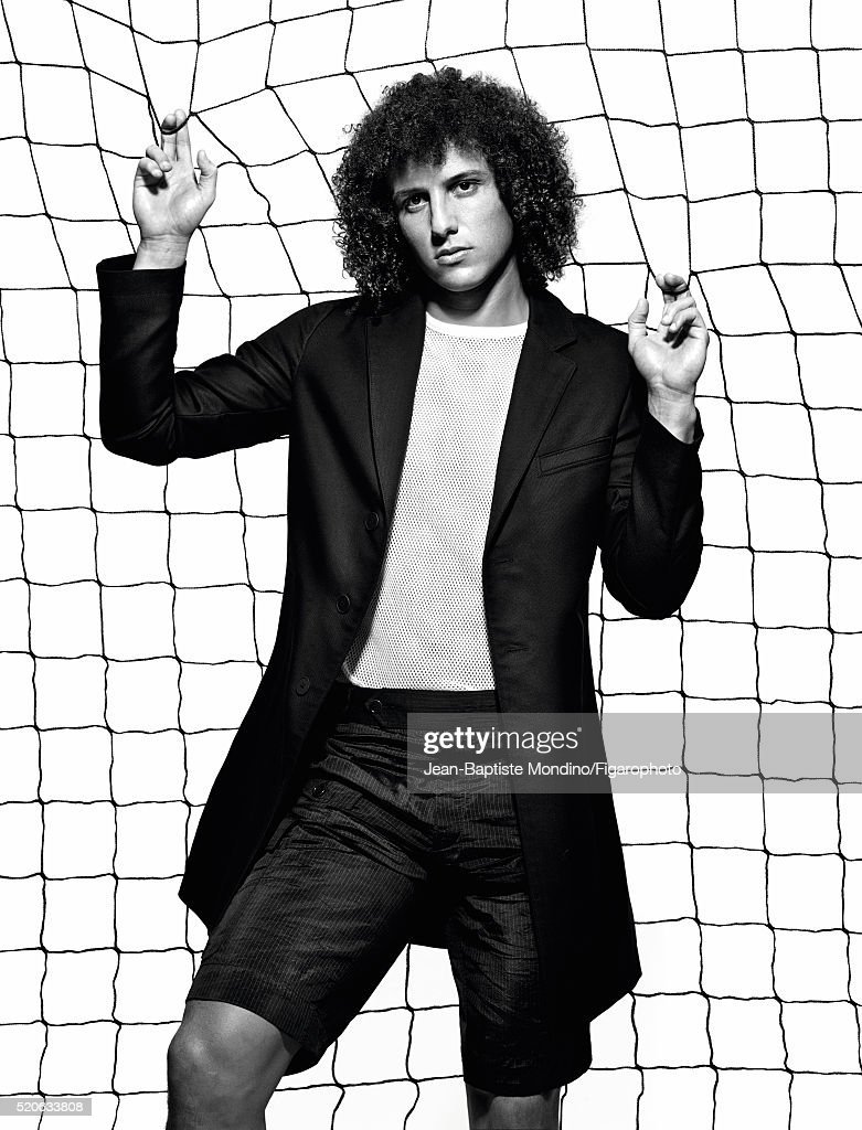 Soccer player David Luiz is photographed for Madame Figaro on February 24, 2016 in Paris, France. Coat (Hugo), t-shirt and shorts (Dries Van Noten). PUBLISHED IMAGE.
