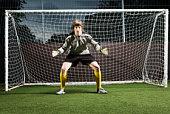 Soccer player defending football goal
