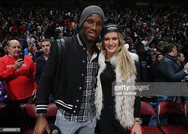 Soccer player Didier Drogba of the Montreal Impact poses with Canaidan tennis star Eugenie Bouchard after the game between the Toronto Raptors and...