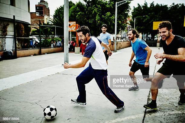Soccer player dribbling ball past opposing players