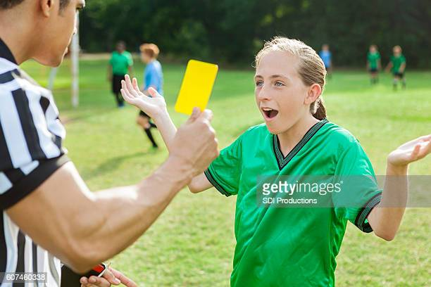 Soccer player is upset over referee's penalty call