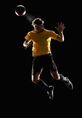 Soccer player jumping in the air to head a ball