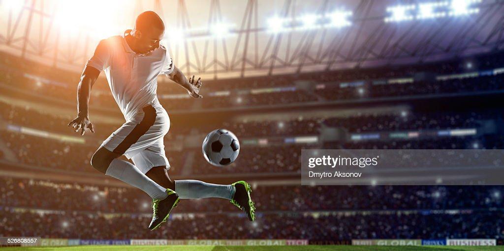 Soccer Player Kicking Ball on stadium
