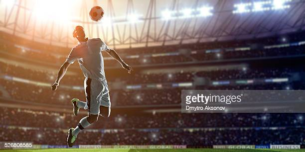 Soccer Player Kicking Ball on stadium