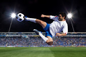 soccer player kicking in stadium