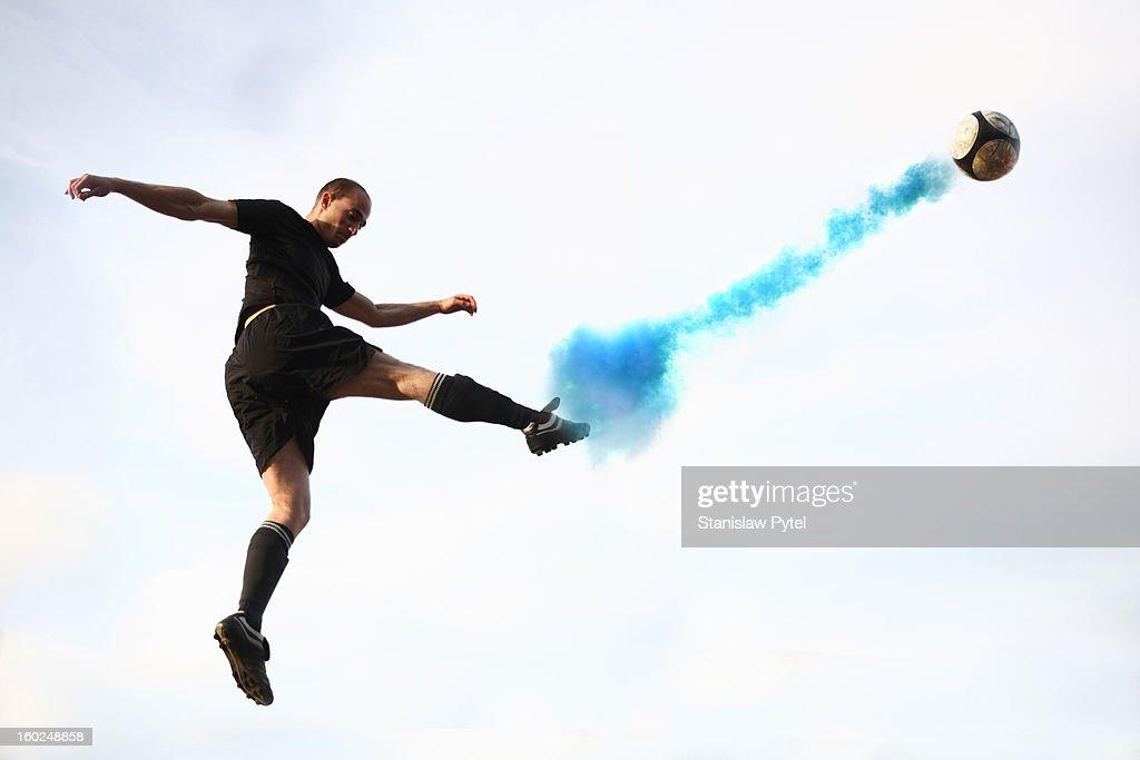 Soccer player kicking smoking ball