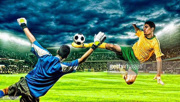 Soccer player kicks football in the air