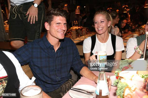 Soccer player Mario Gomez and his wife Carina Wanzung during the Oktoberfest at Theresienwiese on September 23 2017 in Munich Germany