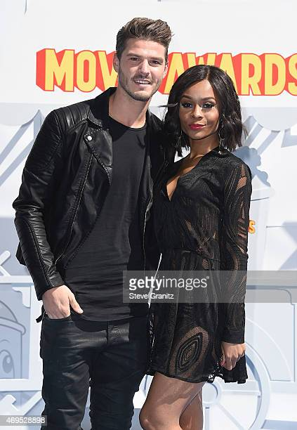 Soccer player Mettin Copier and TV personality Zuri Hall attend the 2015 MTV Movie Awards at Nokia Theatre LA Live on April 12 2015 in Los Angeles...