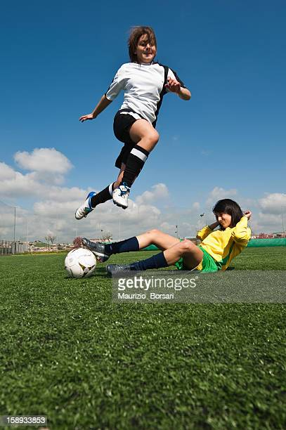 Soccer player obstructing her opponent