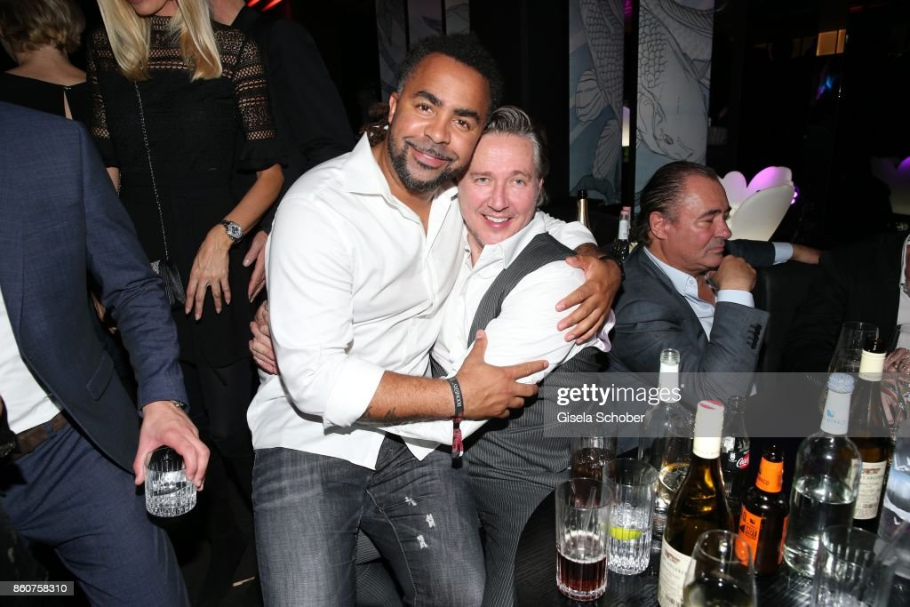Soccer player Patrick Owomoyela and Franjo Pooth during the grand opening of Roomers & IZAKAYA on October 12, 2017 in Munich, Germany.