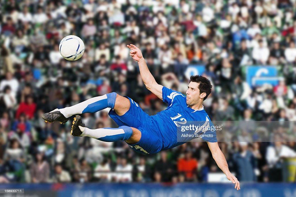 Soccer player performing aerial kick