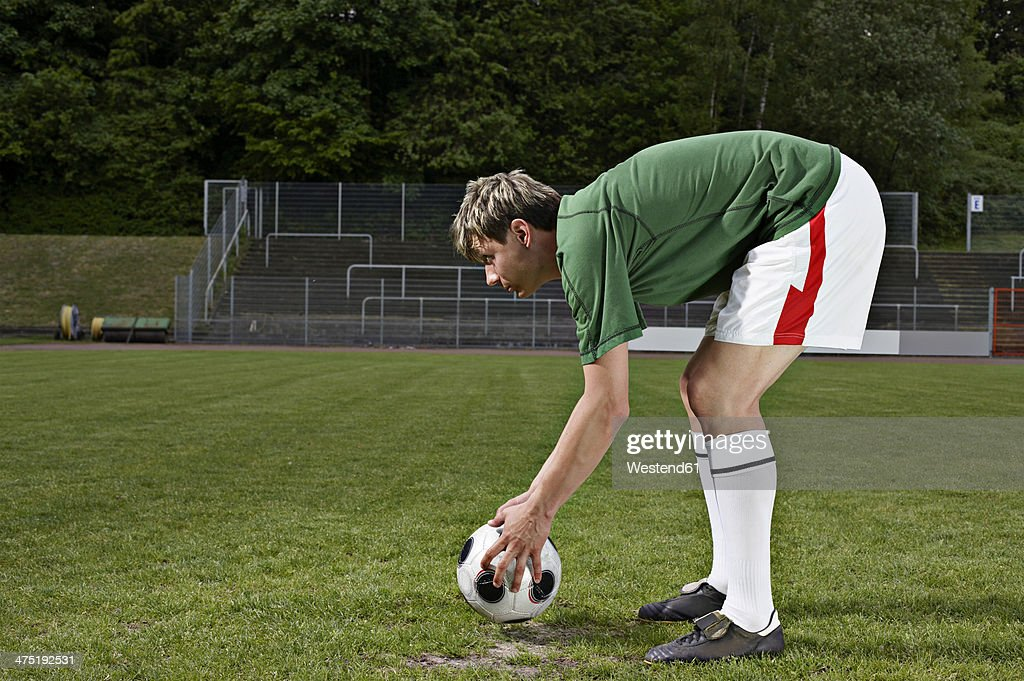 Soccer player placing ball on penalty spot : Stock Photo