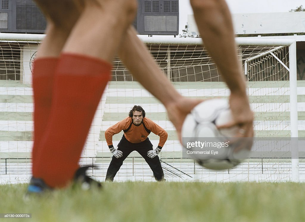 Soccer Player Placing Ball : Stock Photo