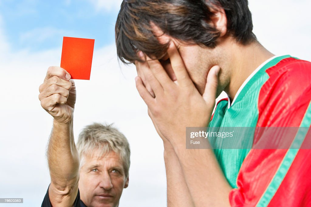 Soccer Player Receiving Red Card : Stock Photo