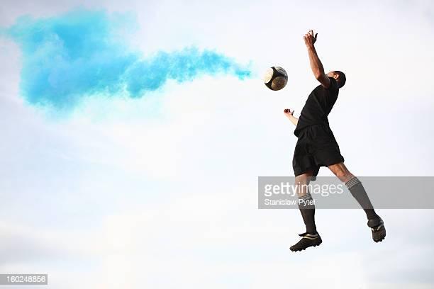 Soccer player receiving smoking ball