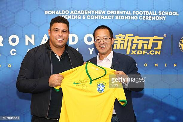 Soccer player Ronaldo and Yu Minhong founder and chairman of New Oriental Education and Technology Group attend the opening and contract signing...