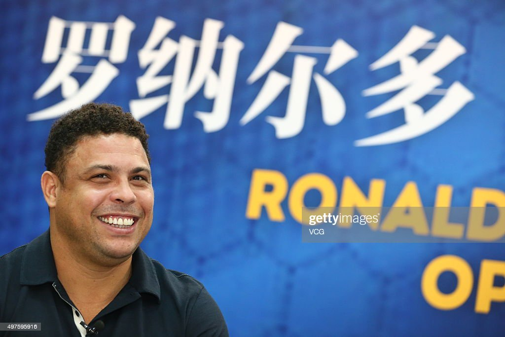 Soccer player Ronaldo attends the opening and contract signing ceremony of Ronaldo Academy-New Oriental Football School on November 17, 2015 in Beijing, China. Brazilian soccer player <a gi-track='captionPersonalityLinkClicked' href=/galleries/search?phrase=Ronaldo+Nazario+-+Soccer+Player&family=editorial&specificpeople=185240 ng-click='$event.stopPropagation()'>Ronaldo Nazario</a> cooperated with the New Oriental Education and Technology Group to open a football school on Tuesday in Beijing as he planned to open 30 football schools in China.