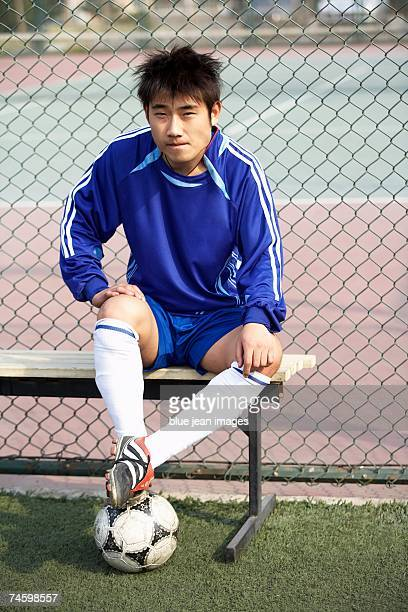 Soccer player sits on the bench