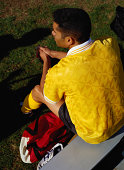 Soccer Player Sitting on a Bench
