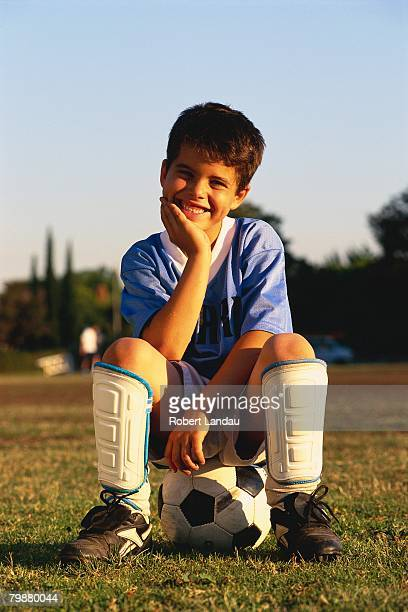 Soccer Player Sitting on Ball