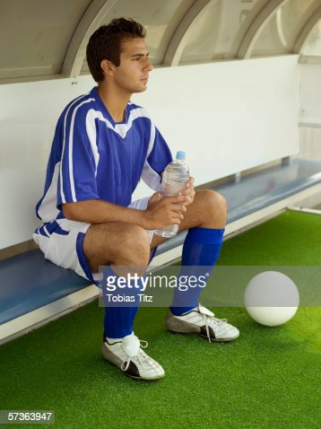 A Soccer Player Sitting On The Bench Stock Photo Getty Images