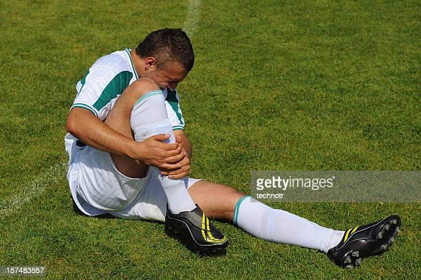 Fußball-Spieler, die unter Verletzung