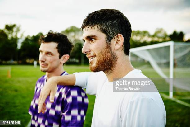 Soccer player with teammate after match