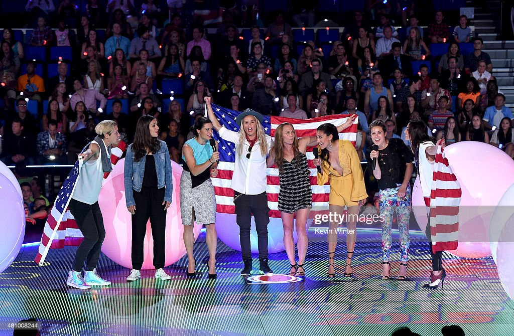USWNT soccer players <a gi-track='captionPersonalityLinkClicked' href=/galleries/search?phrase=Abby+Wambach&family=editorial&specificpeople=162757 ng-click='$event.stopPropagation()'>Abby Wambach</a>, <a gi-track='captionPersonalityLinkClicked' href=/galleries/search?phrase=Carli+Lloyd&family=editorial&specificpeople=736799 ng-click='$event.stopPropagation()'>Carli Lloyd</a>, <a gi-track='captionPersonalityLinkClicked' href=/galleries/search?phrase=Ali+Krieger&family=editorial&specificpeople=7227841 ng-click='$event.stopPropagation()'>Ali Krieger</a>, <a gi-track='captionPersonalityLinkClicked' href=/galleries/search?phrase=Ashlyn+Harris&family=editorial&specificpeople=4640329 ng-click='$event.stopPropagation()'>Ashlyn Harris</a>, <a gi-track='captionPersonalityLinkClicked' href=/galleries/search?phrase=Christie+Rampone&family=editorial&specificpeople=737139 ng-click='$event.stopPropagation()'>Christie Rampone</a>, <a gi-track='captionPersonalityLinkClicked' href=/galleries/search?phrase=Christen+Press&family=editorial&specificpeople=9019492 ng-click='$event.stopPropagation()'>Christen Press</a>, <a gi-track='captionPersonalityLinkClicked' href=/galleries/search?phrase=Kelley+O%27Hara+-+Soccer+Player&family=editorial&specificpeople=4412490 ng-click='$event.stopPropagation()'>Kelley O'Hara</a> and <a gi-track='captionPersonalityLinkClicked' href=/galleries/search?phrase=Hope+Solo&family=editorial&specificpeople=580524 ng-click='$event.stopPropagation()'>Hope Solo</a> speak onstage at the Nickelodeon Kids' Choice Sports Awards 2015 at UCLA's Pauley Pavilion on July 16, 2015 in Westwood, California.