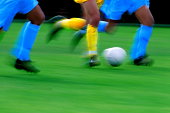 Soccer players, blurred motion, close- up (Digital Enhancement)