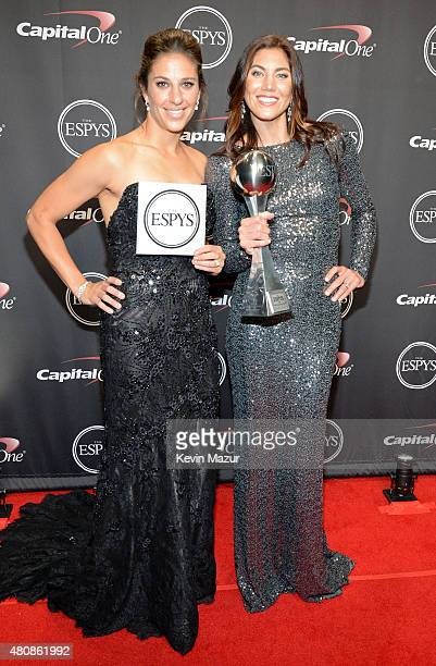 USWNT soccer players Carli Lloyd and Hope Solo accepting award for Best Team at The 2015 ESPYS at Microsoft Theater on July 15 2015 in Los Angeles...